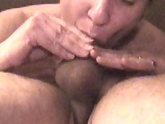 While she laid on top of me and sucked my cock, I surprised her with a big load in her mouth.