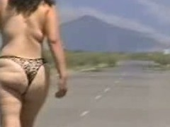 Out in the open desert walking in the middle of a highway with only a g-string covering her big a-hole body. In this public sex video u can see this mature slut walk bare out in the open and flaunt her big fucking ass.