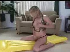 Shaye rides her inflatable float  to make herself cum