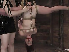 Claire Adams has Trinity Post's pussy wired. She's not only tied up but upside down, and gagged to boot. She's got a metal plug in her cunt and Claire's using a vibrator on her clit, making her want to cum. She gets permission to cum and she does several times, moaning loudly through her ball gag.