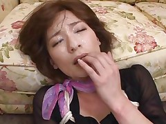 She gets grabbed by the hair and her mouth is filled with a hard dick that goes all the way in her throat. This sexy milf doesn't likes the way she's brutalized but her pussy likes it and soon she discovers that the rough mouth fucking makes her horny. After a cumshot on her face she begins to masturbate