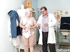 Bozena is a older lady with large boobs, slutty face and large ass. After doctor asks her to undress he is using a sucking machine to make her teats harder. This doc has a dirty mind and surely he is making her horny, who knows what tricks he has to make this old wench ready to fuck.