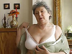Granny takes off her shirt and brassiere and her heart rate increases as this babe begins massaging these large saggy boobs. Just like in her youth this fucking whore takes off her clothes to pleasure men! Granny removes these white panties and reveals her saggy hairy muff that she's enjoys rubbing. What she's up to next?