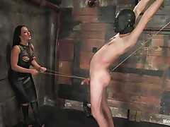 Marioara is a slut from Romania, this bitch has the skills to satisfy every man that desires some domination and pain. Here she is in full action taking good care of her sex slave, Lefty, and she does her best first by using a rope between his legs and then whipping him, now she strapped on a dildo, what will she do with it?