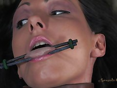 Hot brunette floozy Wenona has her tongue, hand and legs spread and tied up on the bed. Then, a man called Matt comes and sticks his big weenie in that juicy cunt of hers. This chab begins fucking her so hard and they are both moaning with so much pleasure. She is such a sexy slut and that makes Matt very horny.