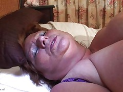 Brigit is one of those huge granny women that could gulp a sex tool like a candy bar. She is masturbating and inserts that sex toy in her vagina all the way in making sure she has it inside. Her bulky cunt gets it with no problems and now she can enjoy herself. She is huge but her sex drive is even bigger then her.