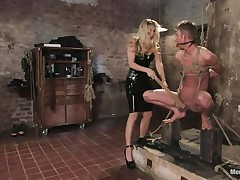 She got her guy tied pretty nice and now she's having some pleasure with his body, paying a lot of specific attention to his cock. This sexy bossy milf with blond hair and fit body is using her tools to taunt and induce pain to her man. Look at her thrashing his jock and body as he's tied up and ball gagged.