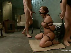 This brown hot bitch is a prisoner of this two guys. She is naked and bounded and she sits on the floor and waits to be punished by these guys with big cocks. One of them fucks her mouth and after that he penetrates her wet vagina. The slut screams of pleasure and she is ready for a threesome.