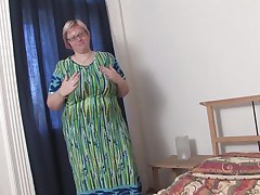 As u can see, Wiske is a large woman who really can't live without herself. That babe rubs her gigantic chest throughout her dress silently as the cameraman takes pictures. Soon the dress comes off revealing a brassiere that can easily hold 2 watermelons. That babe grabs her monstrous mammaries, squeezing and licking them. Wow!