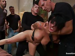 Eva Angelina is a white 27 years old american girl with a nice pair of tits which has the bad luck to be surrounded by five horny guys who like rough fucking. They test her mouth size by inserting their dicks so deep until she can't even breathe. Next, they spread her legs and alternative fuck her