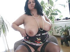 This chubby mature is going insane and definitely in need of some masturbation. So with out wasting any time she is revealing her huge boobs and crushing them to make her pussy wet. After she is rubbing her pussy and fingering it. As soon as is becomes wet she is licking her love juice through her hands.