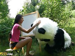 Mr. Panda is outside in the middle of nature and the thin brunette chick that's with him wants to prove him what an artist she is. Well, she may not be good at painting but she surely knows how to make him happy by sucking his big panda cock. Stay with them and enjoy the wilderness of the forest and much more