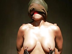 Sexy Beretta sits on a chair with her hands tied up and is mouth gagged. With her nipples tortured, her executor moves to her tiny vagina and puts a pump on it to suck it all in. The bitch moans with pleasure, while he sticks a vibrator on her wet cunt and grabs her nipples a little. This is so hot!