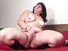 Mandy J. is a busty mature. She is so out of control that if she has gone horny no one can stop her from putting a dildo in her pussy. The same thing has happened here. At first she is crushing her boobs like hell. Then she is putting her finger in her pussy to make it wet and right after that she is inserting a big black dildo in her pussy.