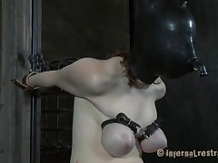 Pale and with a fragile body, this brunette is the subject of an hardcore bdsm session. She's masked and her breathing rationalized, her boobs are squeezed hard and that tight pussy between her long legs is drilled deeply. Her name is Dixon and she reached the human endurance limits, or did she?