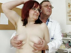 Brunette mature lady is lying on the gynecologist's table and the doctor is examining her pussy. He is wearing gloves and fingering her pussy right after he examines her nice small tits. He is inserting a thin medical tool in her tight ass. You really needs to see where the doctor ends up.