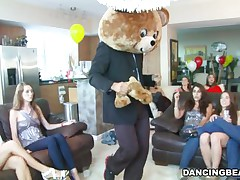 They were all sitting around in a circle when the dancing bear entered and slowly started stripping his clothes off until he has undressed to his skin. They are enjoying the sight of a huge full blown dick that they can sample with their mouth. Many of them gives him a oral as he gains attention.