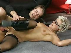 Shorthaired mature takes it in the one and the other holes